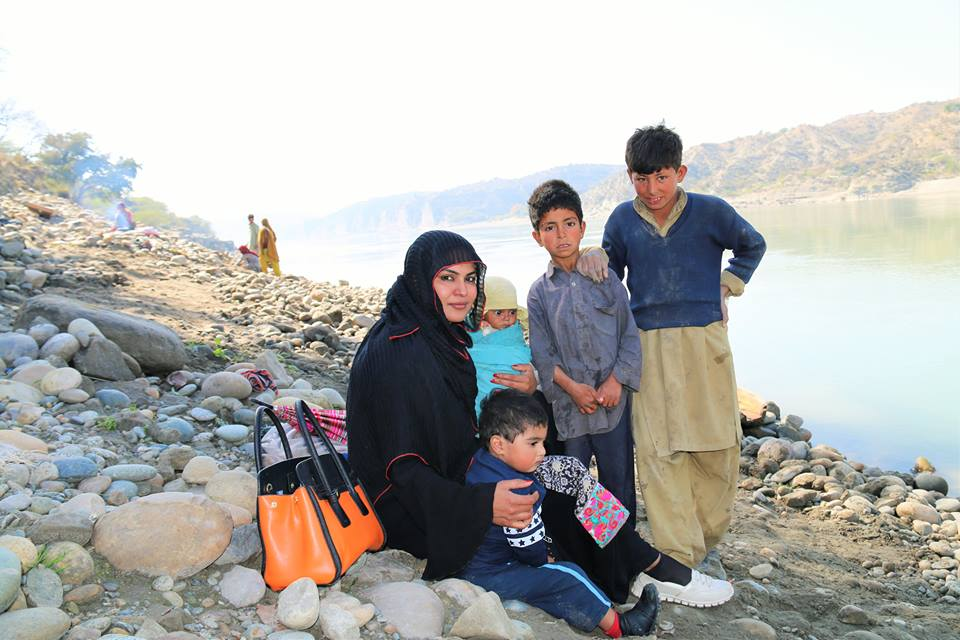 Veena Malik with a Village Family near River Indus